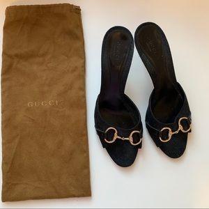 Black Gucci logo heels gold hardware